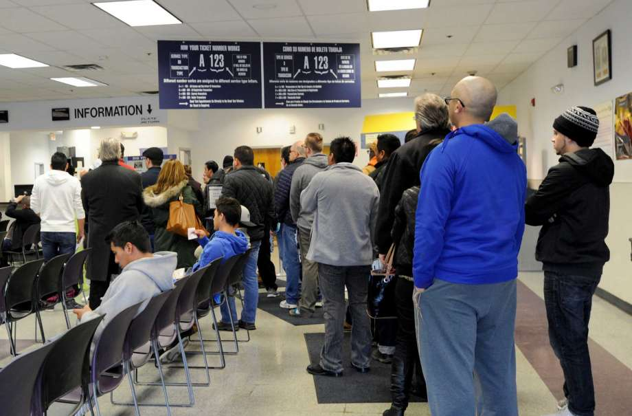 Patrons Standing in Line at DMV